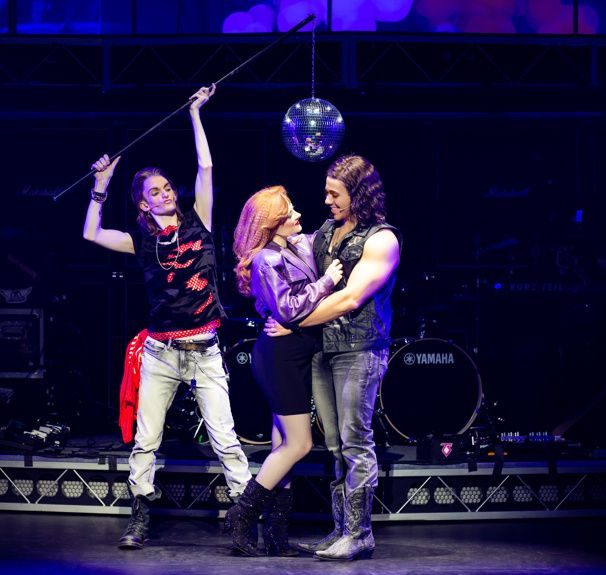 2 lovers embrace while a rocker holds a disco ball to set the mood.