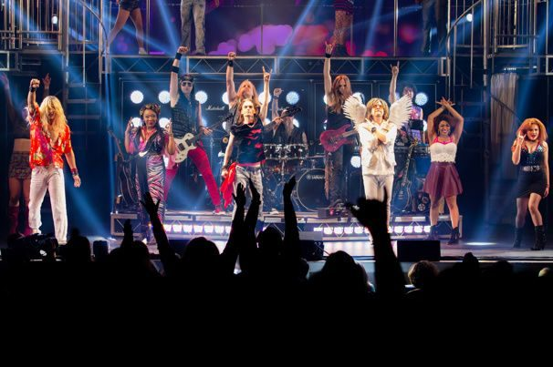 All main characters salute on stage at the finale of the show.