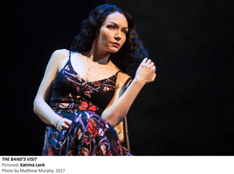 Katrina Lenk (Dina) stands alone on stage.